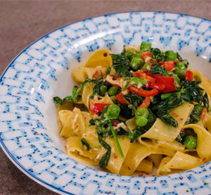 Pappardelle with sweet peas, spinach and red Florina-type peppers