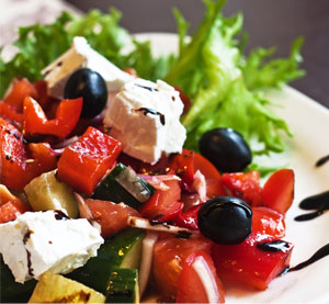 Mediterranean salad with peppers, feta cheese and olives