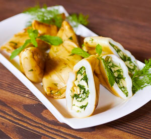 Stuffed squid with aromatic herbs and mustard sauce