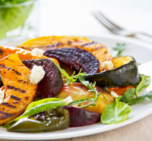 """Roasted Vegetable Salad with """"Manouri""""* cheese and balsamic sauce."""