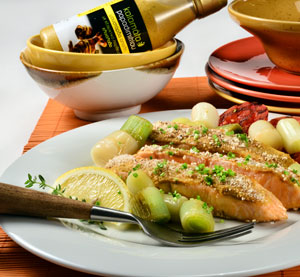 Salmon with Mild Mustard Kalamata Papadimitriou and a Crust of Puffed Rice Cakes, served with Tomatoes and Leeks.