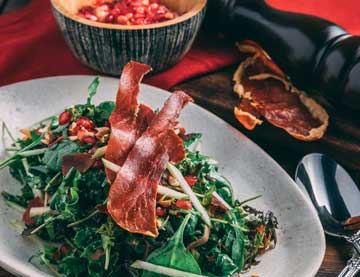 Green Salad with Prosciutto and Hazelnuts and Pomegranate Vinaigrette
