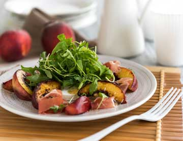 Salad with Roasted Peaches, Manouri* cheese, Prosciutto and Rocket
