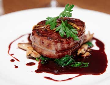 Bacon wrapped Beef Filet, with Pomegranate Balsamic Cream